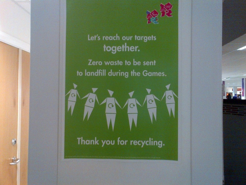 Recycling is another point of emphasis. Here's a sign from the press-center cafeteria—which, by the way, serves meat and fowl only from animals raised as humanely as possible (short of actually leaving them alive).