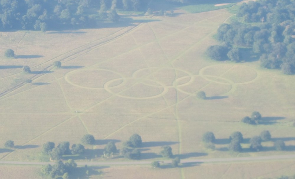 Must be London: As our plane descended into Heathrow, I noticed the Olympic rings mowed into a field.