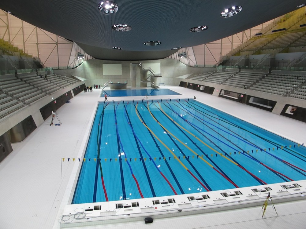 The $421 million aquatics center was designed by Iraqi-born architect Zaha Hadid (a woman) and sits near the Olympic stadium and the velodrome. This is what the place looked like last fall when I and other international journalists toured it and other London Olympic venues. One woman reporter in our group dipped her finger in the diving pool (the pool in back) before being scolded. In case you're wondering what Michael Phelps, Ryan Lochte and other swimming stars will feel when they dive in, the water temperature of the pool will be kept at 78.8 degrees Fahrenheit (26 degrees Celsius) for competition.