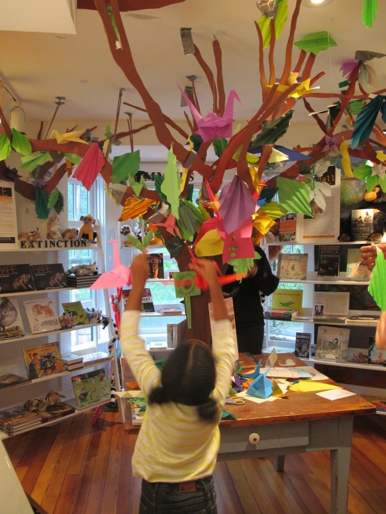 Some visitors had to jump to add their origami creations to the tree created in last year's Notebook by Melanie and Anthea.