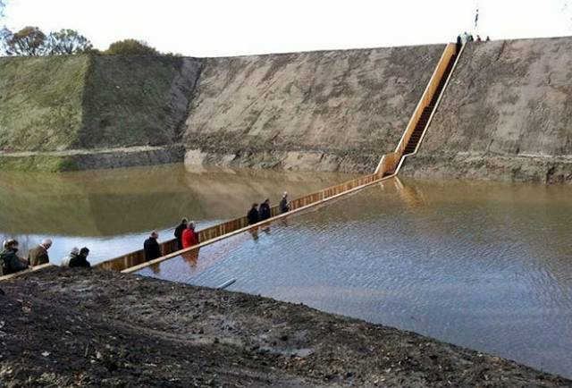 A work of art and engineering, the Trench Bridge in the Netherlands, offers a baseball-dugout perspective on the water.