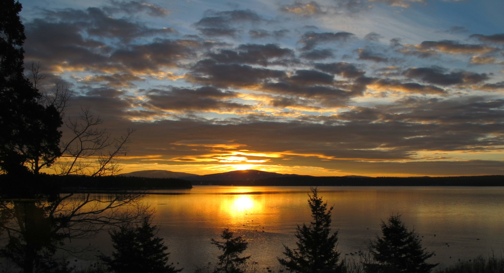 As the Winter Solstice nears, sunrise moves closer to its southernmost point—from our view, just to the right of the peak of Sargent Mountain. That's Cadillac Mountain farther left.