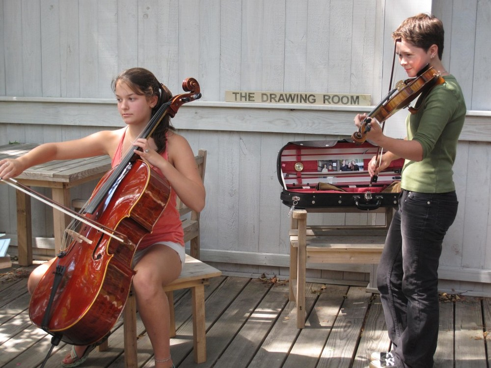 Teen phenoms: Violinist/fiddler Emma Walsh and cellist Melanie Ambler performed on the deck at The Naturalist's Notebook on Thursday.