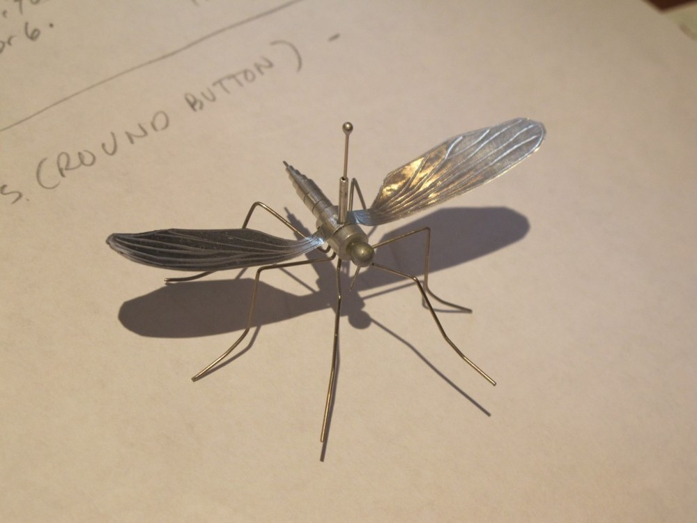 Rocco's mechanical mosquito flies around his artwork now on display at the Notebook.