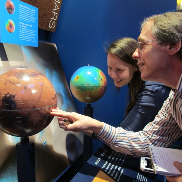 Katie used a Mars globe at NASA's Jet Propulsion Laboratory to show me areas the rover was and was not exploring.