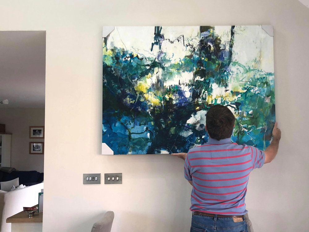 Ella Clocksin (2018)  Soundscape , acrylic on canvas, 106 x 141 cm. Client trying the painting for size in the intended space.