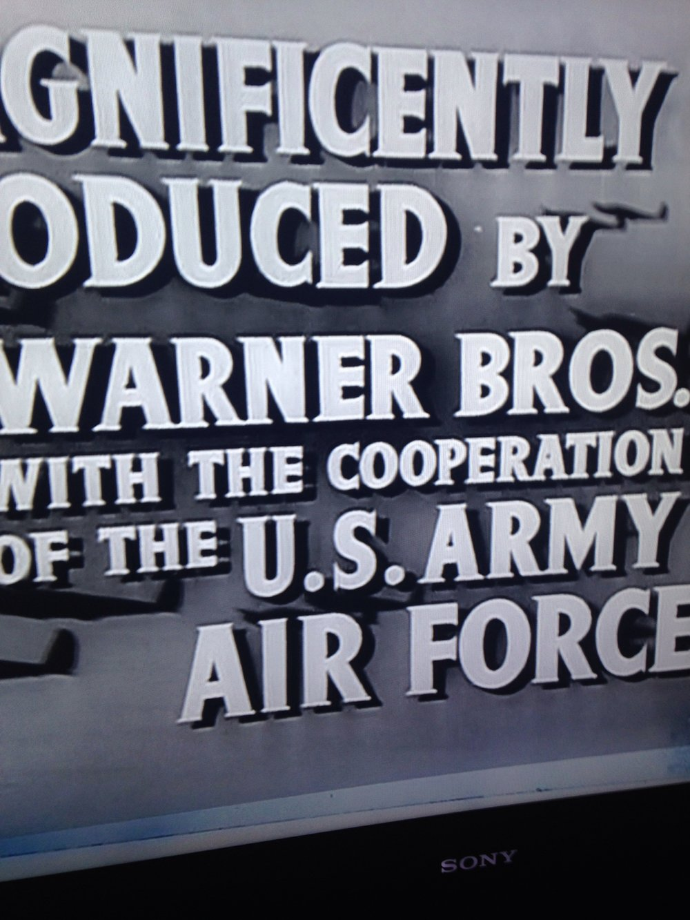 Opening credits, World War II propaganda film, produced by Warner Bros. and the US Office of War Information, 1943.