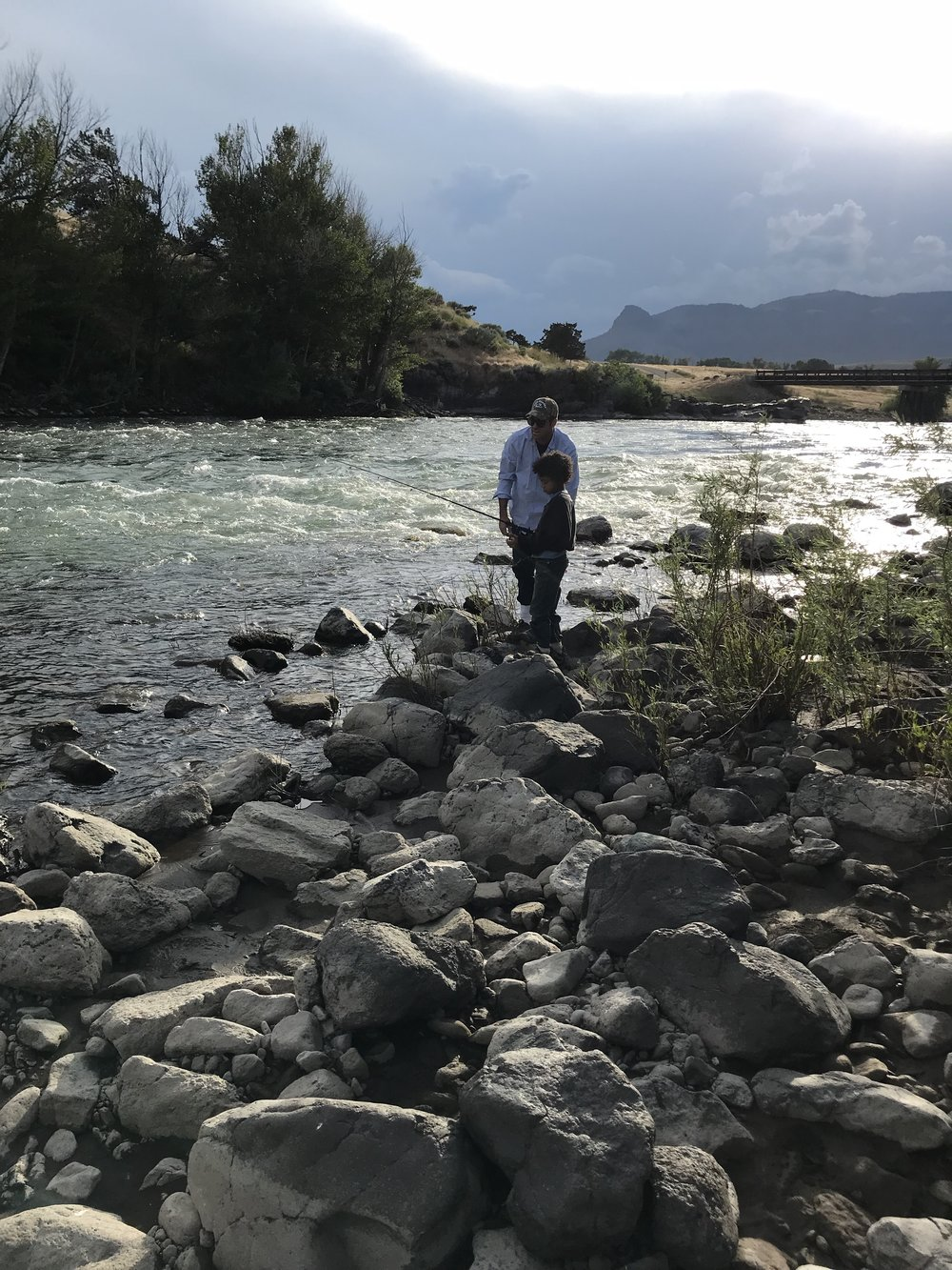 Spencer and his son Trayvion fishing, north fork of the Shoshone River, Wapiti, Wyoming, 7:30 p.m., Tuesday, July 17, 2018.