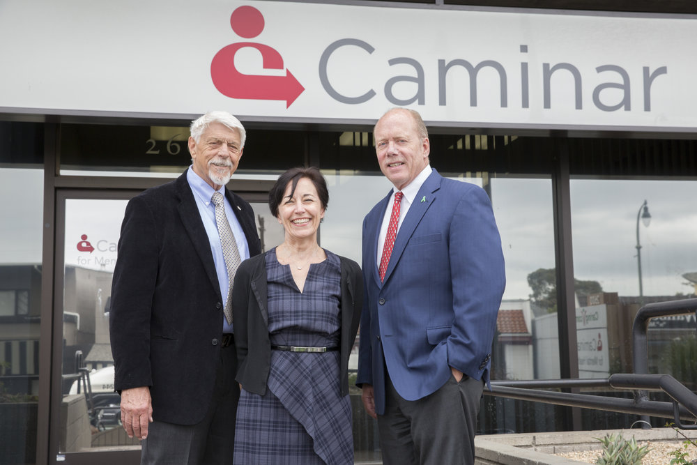 "Jim Stansberry (left) of Project Ninety division, with Caminar COO Karen Gianuario and CEO Charles ""Chip"" Huggins"