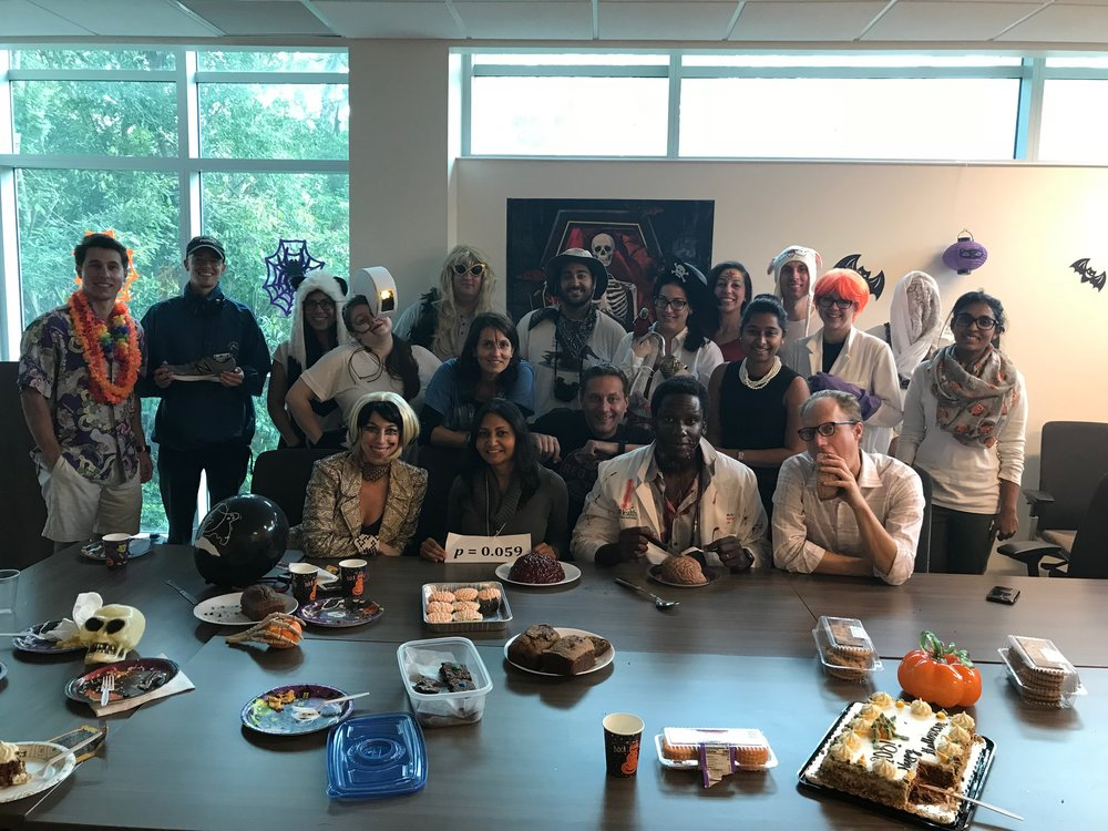 "Steven Anderson as a football coach (back row, second from left); Morgan Gianola as Brain of ""Pinky and the Brain"" (back row, second from right); Jenna Perry as GLaDOS (middle row, first from left); Liz Losin as Lady Gaga (front row, first from left)."