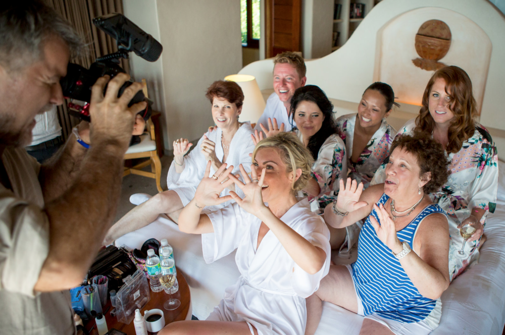 James getting an adorable shot of our bride with her family and friends while getting ready. Lots of laughs on this one! Destination wedding filmmaking in Mexico.