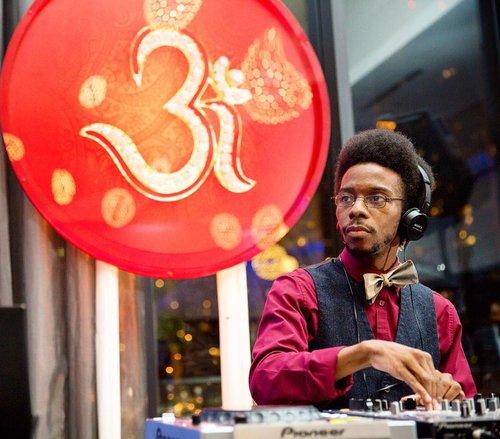 DJ-with-hindu-symbol.jpg