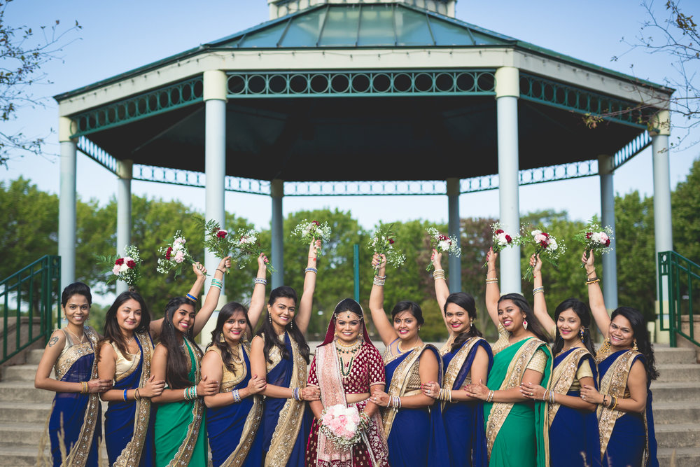 bridesmaids-holding-up-bouquets.jpg