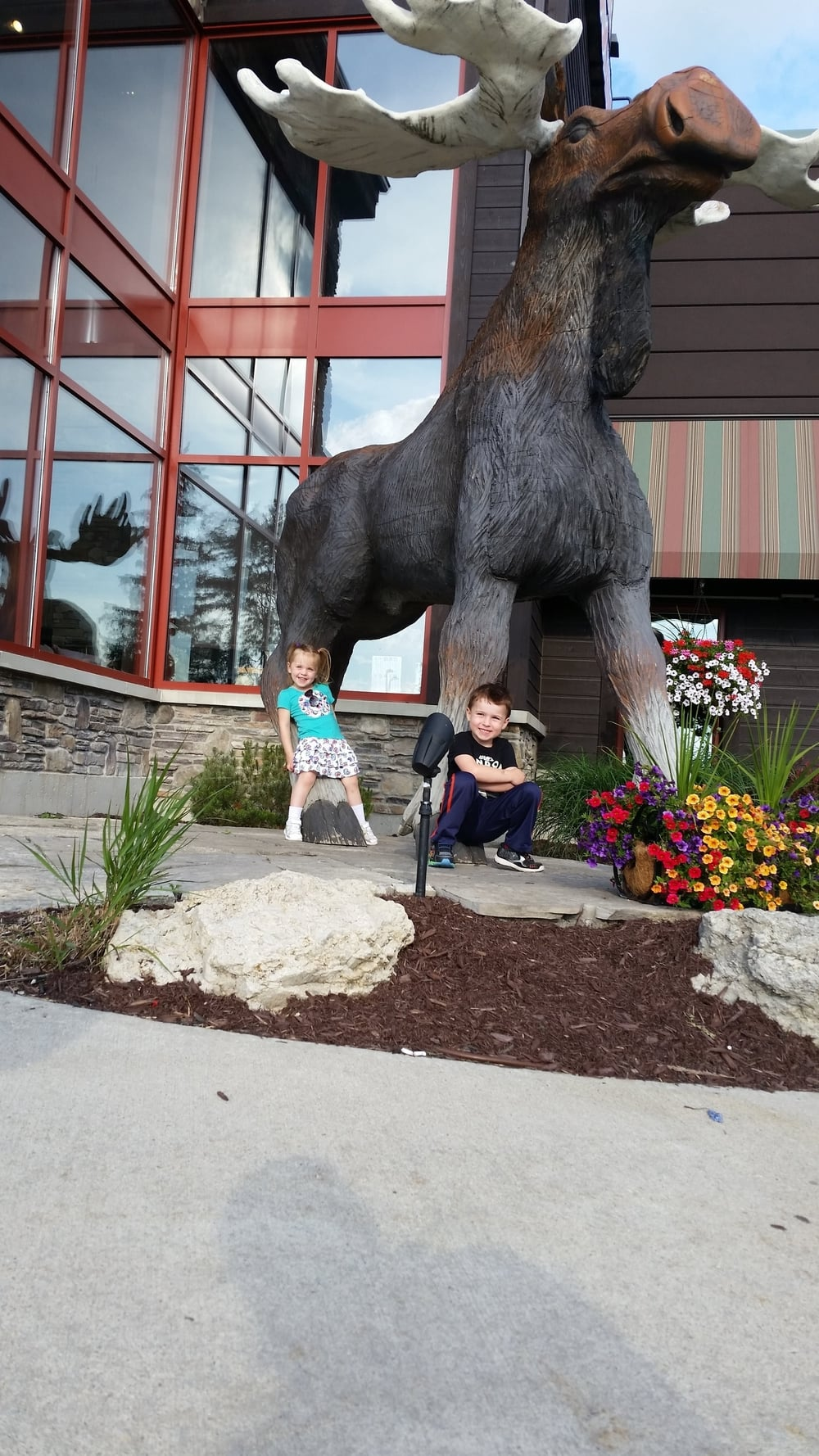 The kids with the moose himself, outside Moose Winooski's Kitchener, a proud carrier of SCS products.
