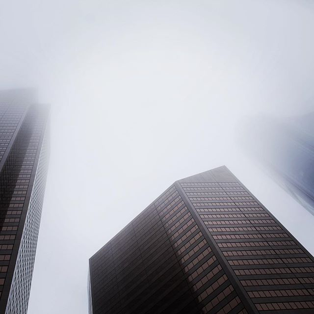 Misty towers in downtown #yyc today. . . . . #yycphotographer #fog #downtown #photography #landscape #explore #explorealberta #alberta #calgary #buildings #bowbuilding