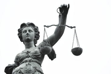 shutterstock_scales of justice statue.jpg