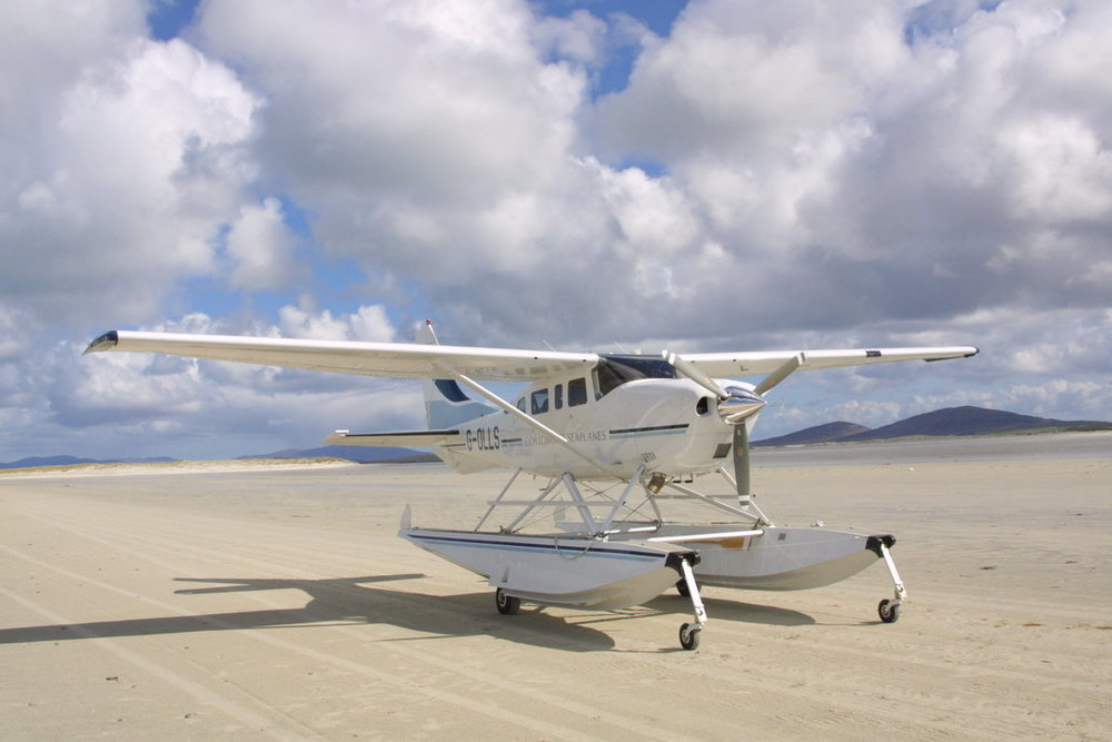 Our first aircraft G-OLLS lands on Sollas Beach, Outer Hebrides 2004