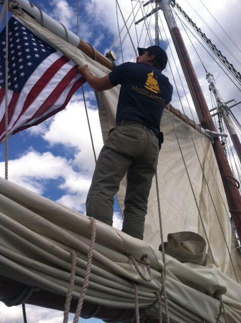Bringing down the Mainsail.