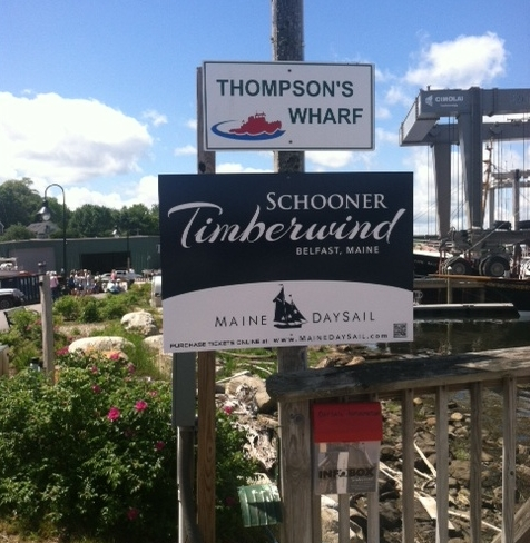 the Belfast harbor walk signage showing thompson's wharf & Schooner Timberwind