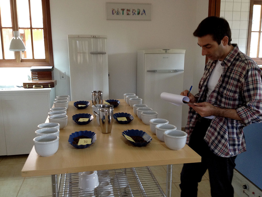 Patrick in Brazil cupping coffee.