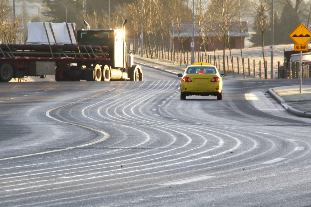 Calcium Chloride - Road users face a serious safety issue of reduced visibility and also the prospect of loose gravel causing cracked windshields, chipped paint, and/or broken headlights