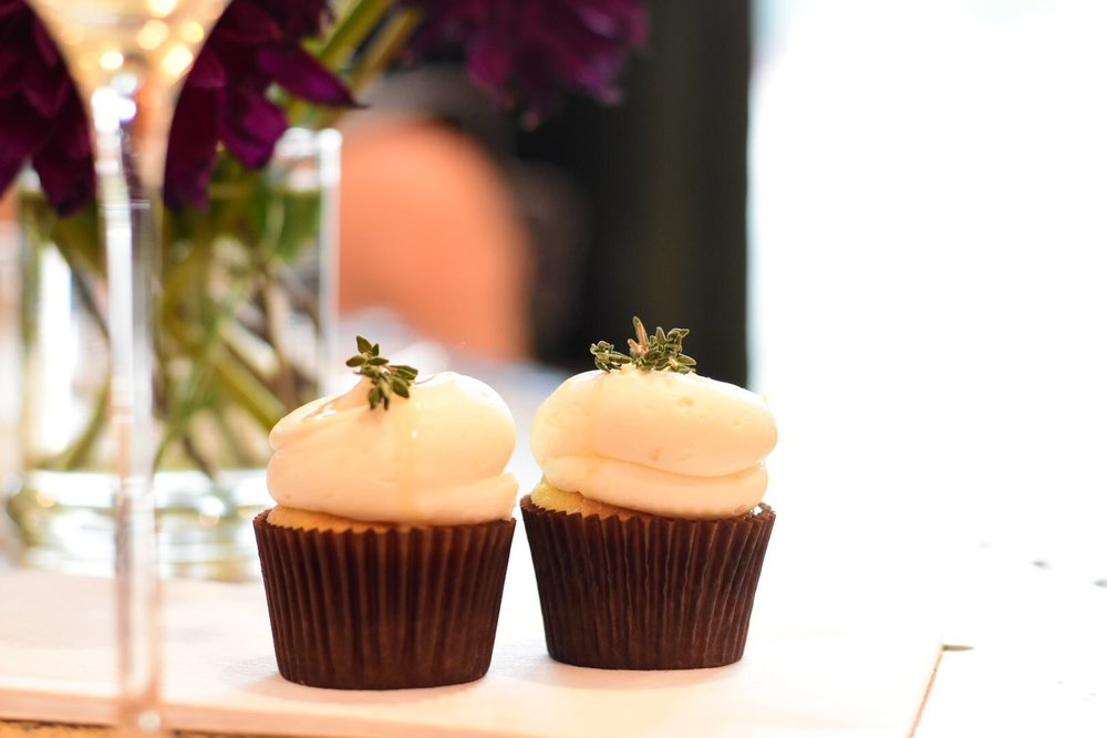 chardonnay : crisp bright, lightly buttery with notes of melon, pear + citrus  lemon + honey + thyme cupcake  a light yet rich dessert, perfumed + flavored with lemon + thyme, accompanied with a creamy lemon honey buttercream + drizzle.