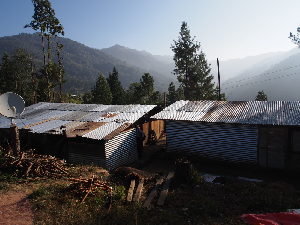 "Temporary Living Shelters in Thulo Dading (and much of Nepal's rural hillsides. While ""temporary,"" these will likely be here for 5+ years given rates of reconstruction."