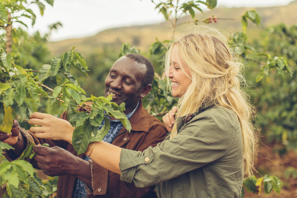 Sarah, our founder, and James, a partner farmer on a coffee farm in Nakuru.