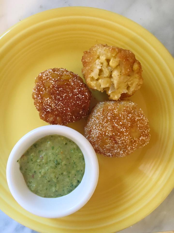 Summer Arancini. Fried risotto, corn, and shallots with a balsamic vinegar, corn, pesto sauce.