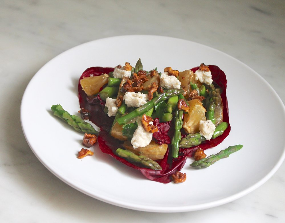 Citrus, asparagus salad topped with toasted walnuts and ricotta.