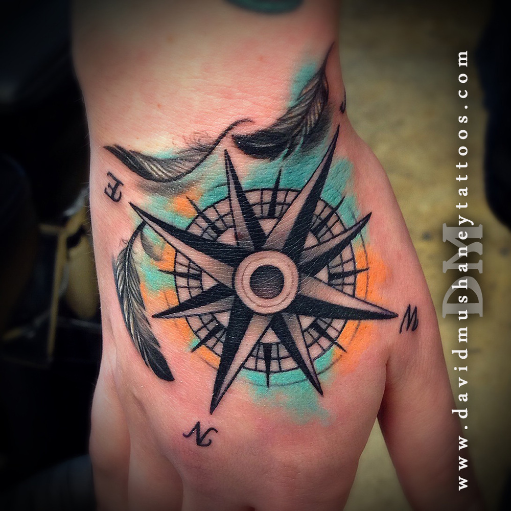 Compass and Feathers Hand Tattoo by David Mushaney