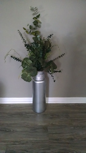 Repainted vase brought out of storage.