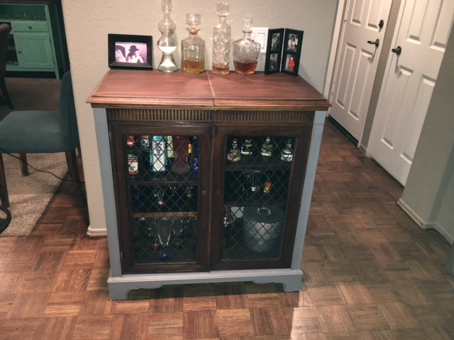 We love, love, love this bar! Bought for $25 at Goodwill and it's turned into such a great piece!