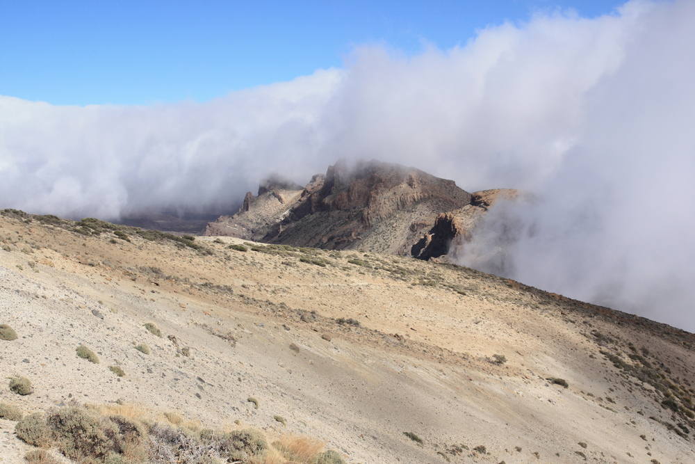 View along the rim of the caldera, with the caldera floor visible beneath the clouds at left (my photo)