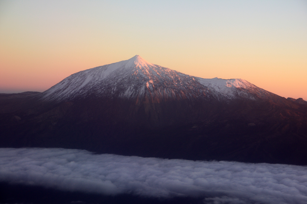 Volcan del Teide, with a dusting of snow at sunset, from the airplane (my photo)
