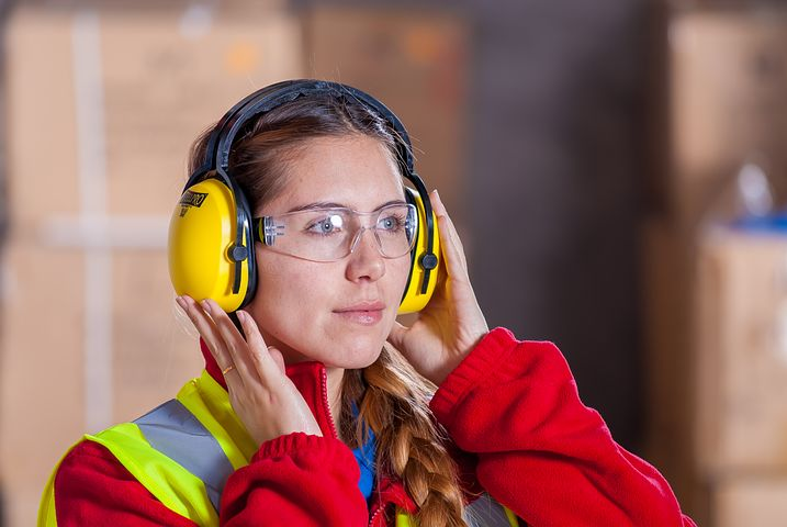 Lady wearing ear muffs courtesy of Pixabay.