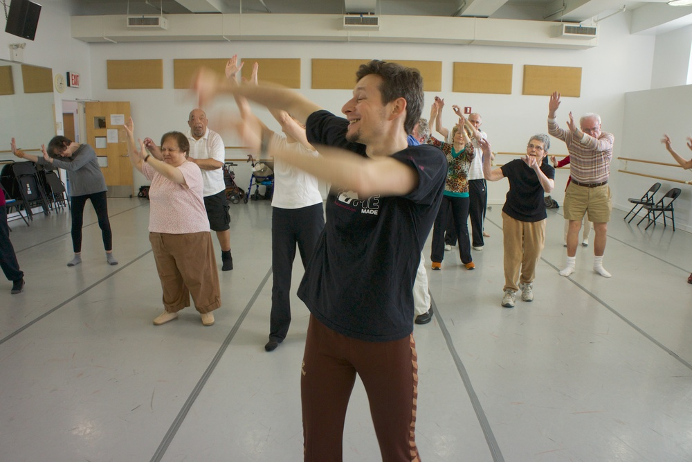 Image, of David Leventhal and participants of a Parkinson's dance class, by Eddie Marritz