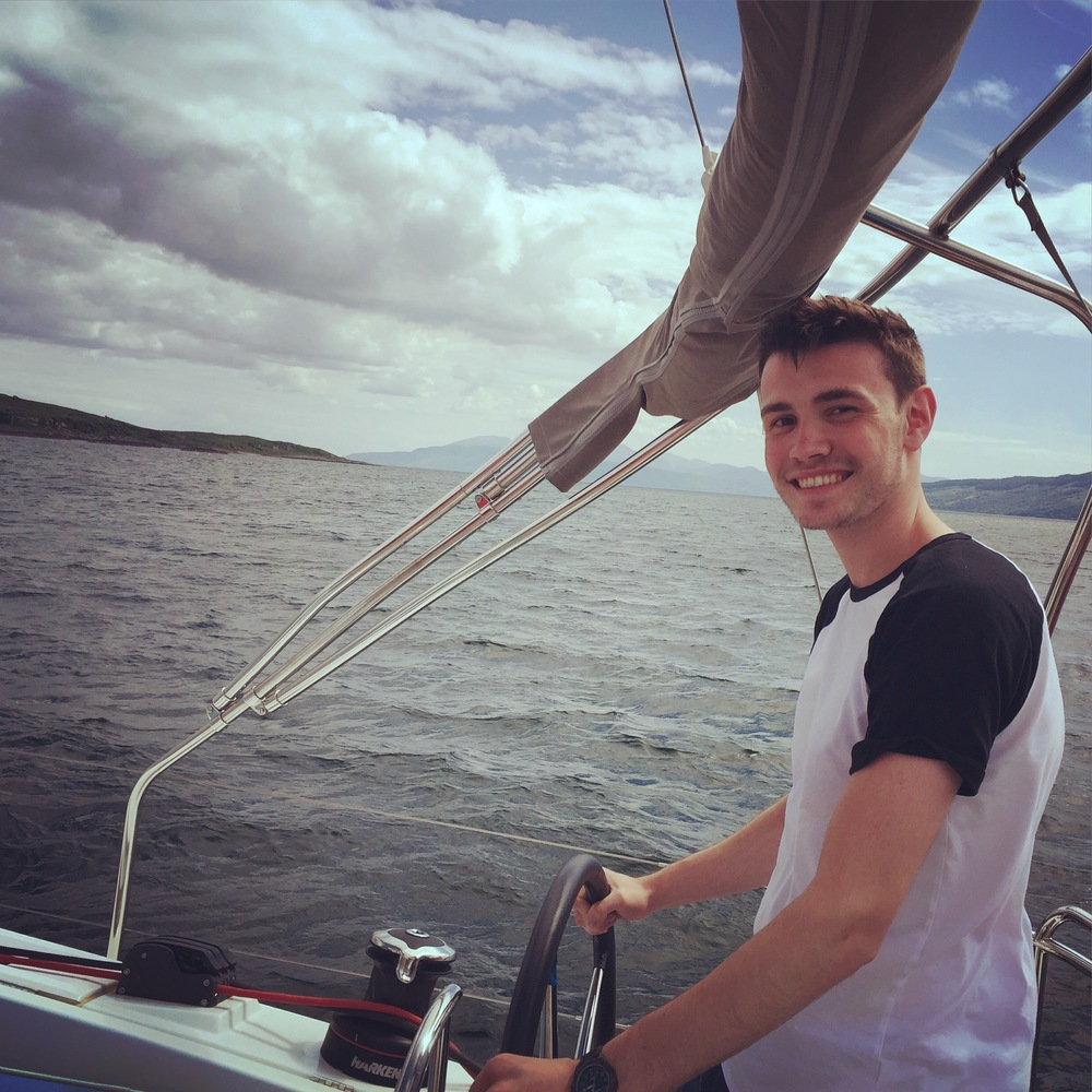 Steering a boat for the first time.Portavadie, Scotland.