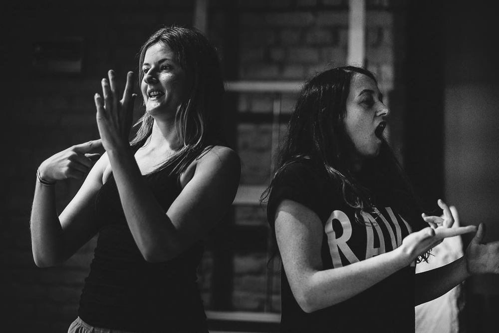 Erin Hutching and Sophie Stone signing in a rehearsal. Photo by David Monteith-Hodge