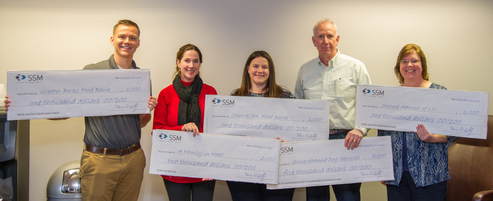 Members of the SSM  Give Back Club  (left to right: Nick Szeredai, PE, Lyn O'Hare, Michelle Hohl, PE, Steve Smith, and Michele Eidle) display checks representing the firm's $10,000 donations.