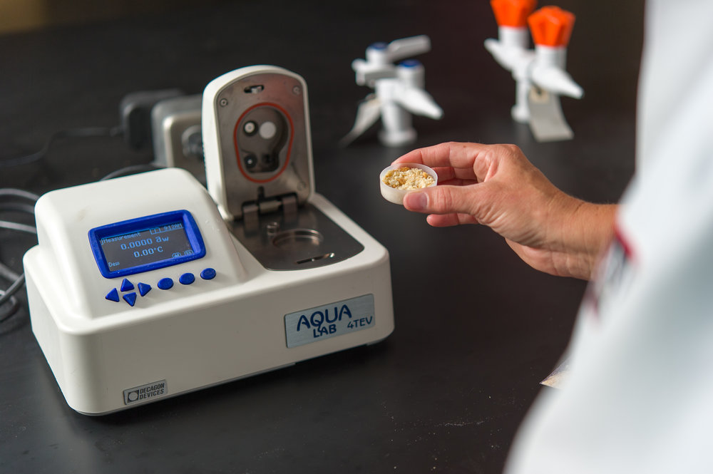 A scientist measures water activity, which is an integral factor of product shelf life.