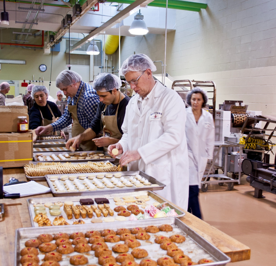 Seminar participants are collecting samples from the day's production.