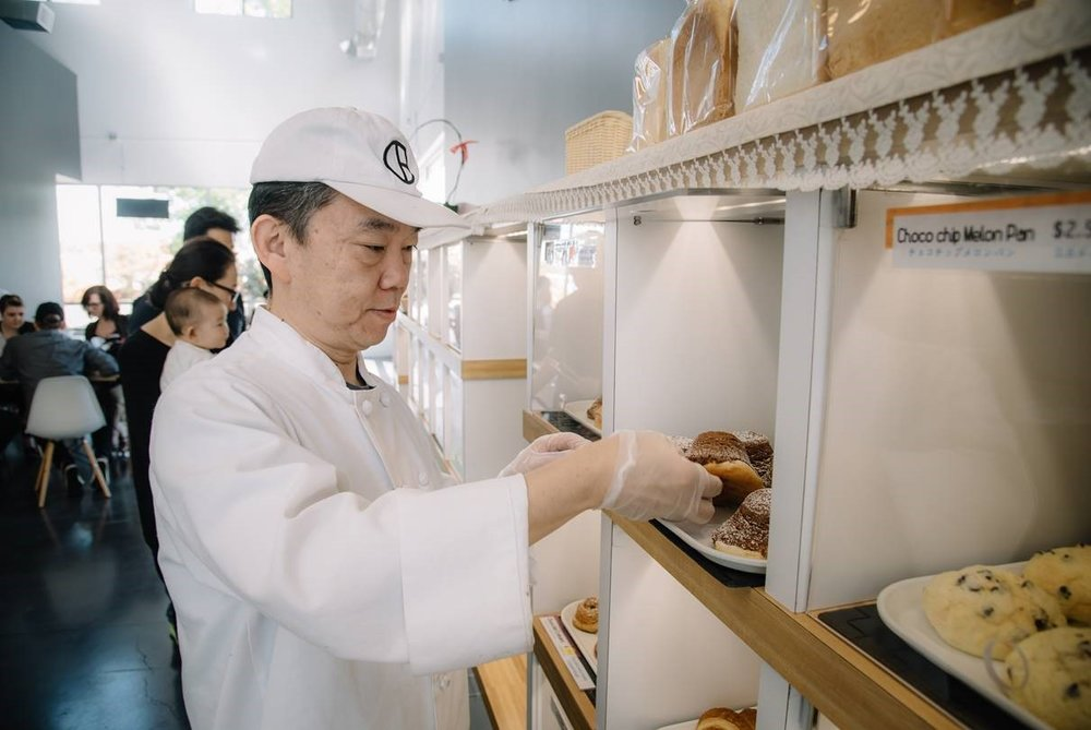 Hiroyuki Horie, BS&T graduate, fills the pastry shelves in his bakery Oyatsupan Bakers in Beaverton, Oregon.