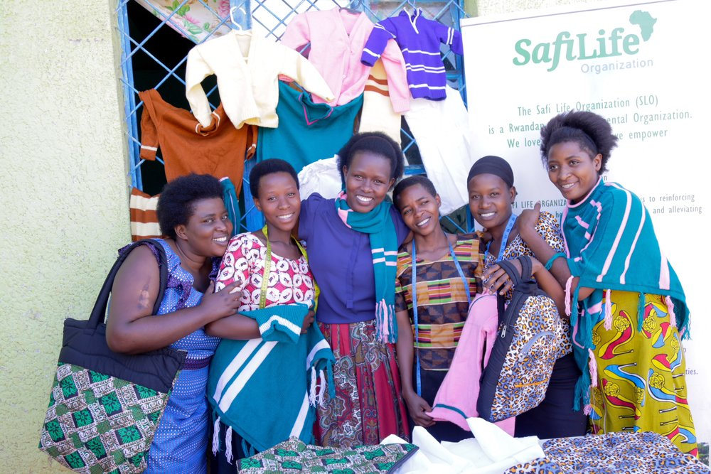 Our 2018 students and our County Director MUKUNDWA Safi selling their incredible hand sewn goods at the market.