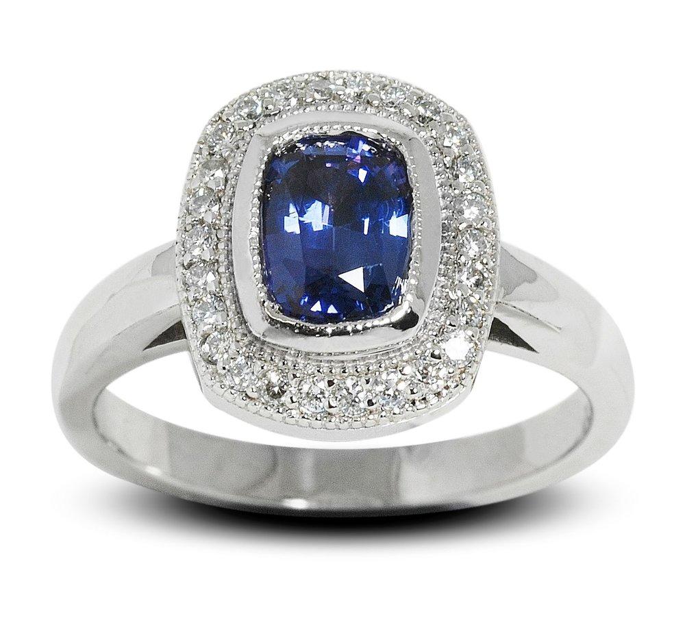 Custom Cushion Cut Blue Sapphire and Diamond Halo Ring