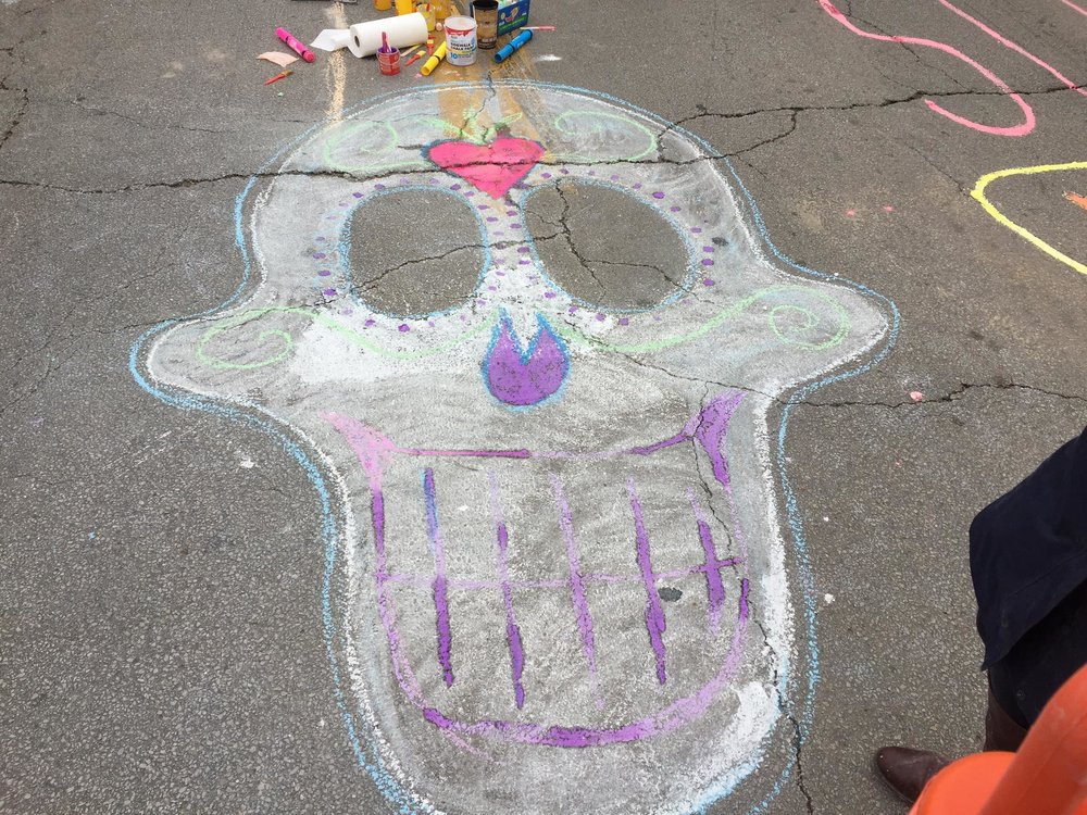 "A  calavera  design chalked on the street on North Denver Avenue by organization Board Member and  Living Arts of Tulsa  artist Mery McNett as part of ""Chalk the Walk."" (Photo © 2017 Brian Parker)"