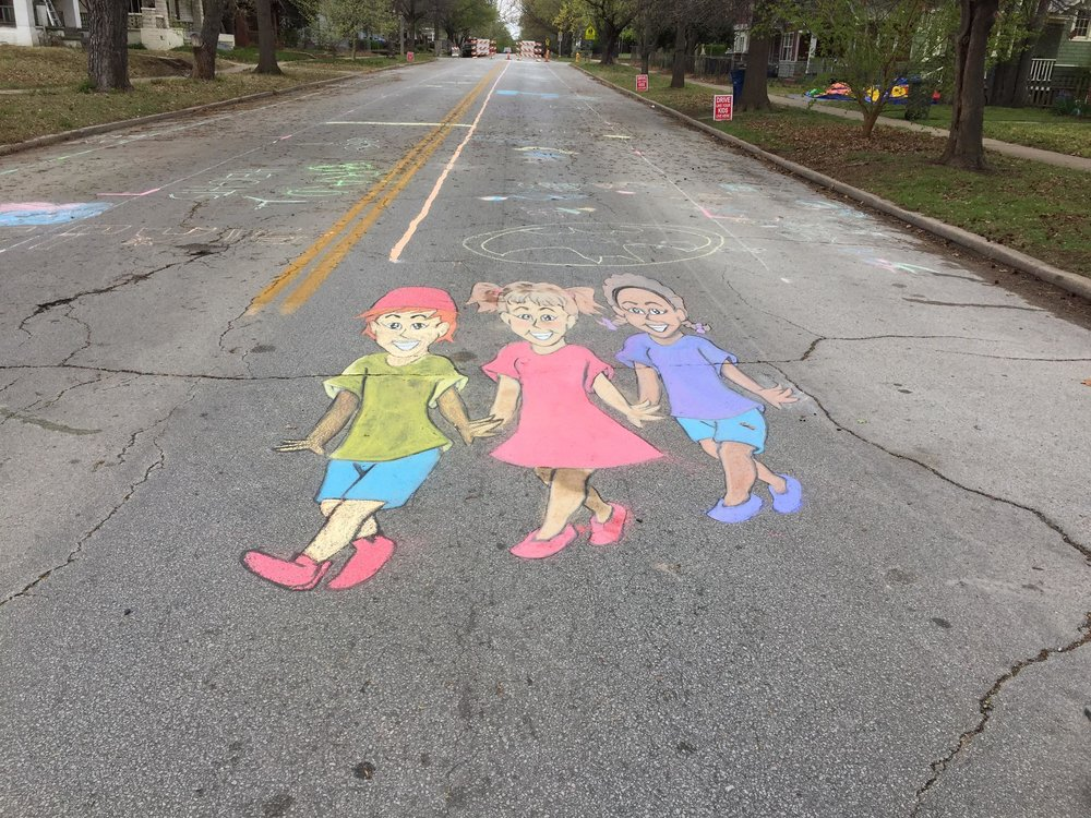 "The final product of the 3D crosswalk design created by chalk artist Amber Crismond and completed during the ""Chalk the Walk"" event. (Photo © 2017 Brian Parker)"