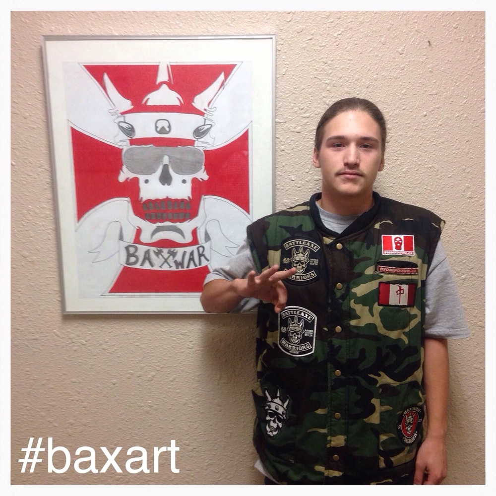 Tier 2 Warrior Caden Young posing with his piece of BaxWar Art!