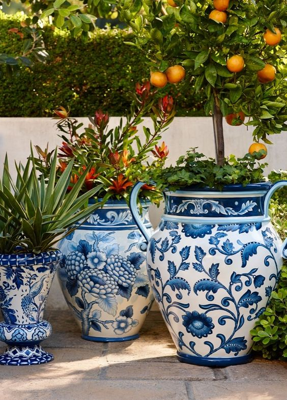These oversized blue and white planters are fabulous. I appreciate the way they bring pattern to the outdoor space. Image from  Frontgate
