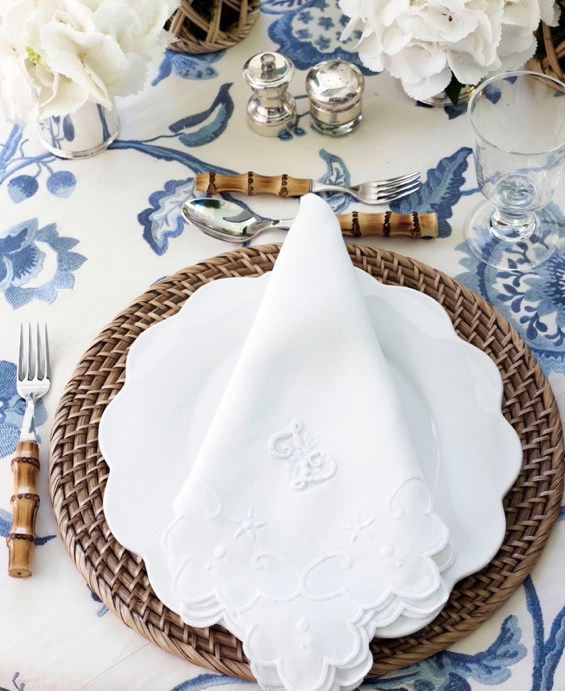 This exquisite blue and white embroidered tablecloth by Aerin Lauder is timeless.  (image from  Habitually Chic ).
